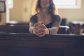 Young Woman Praying In Church Stock Images - 81081844