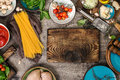 Kitchen Board With Raw Spaghetti And Ingredients For Cooking Pas Stock Image - 81083571