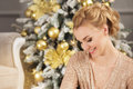 Portrait Of Blonde Young Woman Looks Down And Smiles In Christmas Royalty Free Stock Photo - 81089035