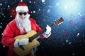 Composite Image Of Smiling Santa Claus Playing Guitar While Standing Stock Image - 81108851