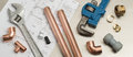 Plumbers Tools And Plumbing Materials Banner On House Plans Stock Photography - 81181532