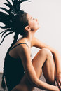Young Sexy Mixed Race Caucasian Woman Vogue Portrait With Feather Mohawk Accessory Wearing Black Bodysuit. Stock Images - 81189434