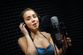 Retro Woman Recording The Sound In Professional Studio With Mic And Phones. Stock Photo - 81194760