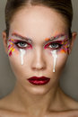 Studio Portrait Of Young Beautiful Woman With Creative Colorful Makeup Stock Photos - 81223733