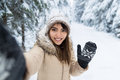 Young Asian Beautiful Woman Smile Camera Taking Selfie Photo In Winter Snow Forest Girl Outdoors Royalty Free Stock Images - 81224229