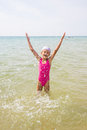 Happy Girl Let Up Splashes Water Standing Royalty Free Stock Photo - 81224865