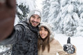 Man Taking Selfie Photo Young Romantic Couple Smile Snow Forest Outdoor Stock Image - 81225101