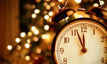 Vintage Alarm Clock Is Showing Midnight. It Is Twelve O`clock, Christmas And Bokeh, Holiday Happy New Year Festive Concept Royalty Free Stock Images - 81250409