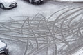 Traces Of Car Tires On Wet Snow During Sleet Royalty Free Stock Photo - 81252475