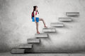 Student With Rucksack Climbing A Stairs Stock Photography - 81339132