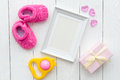 Birth Of Child - Blank Picture Frame On Wooden Background Stock Photo - 81348050