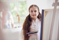 Young Girl Artist About Easel Stock Image - 81361651
