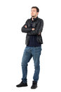 Serious Young Casual Man In Leather Jacket And Jeans With Crossed Arms Looking Away Royalty Free Stock Image - 81369726
