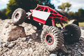 Toy Crawler Overcoming Rock Close-up Royalty Free Stock Image - 81371476