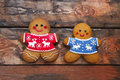 Christmas Gingerbread Men On Wooden Background. Royalty Free Stock Photo - 81375605