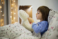 Cute Sick Child, Boy, Staying In Bed, Playing With Teddy Bear Royalty Free Stock Photo - 81379915