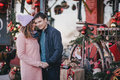 Happy Couple In Warm Clothes Posing On A Christmas Market Stock Images - 81400214