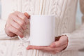 Girl In Warm Sweater Is Holding White Mug In Hands. Stock Photography - 81418522