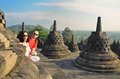 Couple Between Stupa At Borobudur Temple Indonesia Royalty Free Stock Image - 81421946