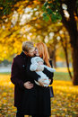 Young Family And Newborn Son In Autumn Park Stock Photos - 81424933