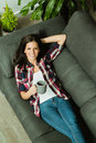 Attractive Brunette Girl Resting On The Sofa Royalty Free Stock Images - 81488069