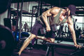 One-arm Dumbbell Rows In Gym Royalty Free Stock Image - 81505486