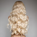 Beautiful Young Blond Woman With Long Wavy Hair. Stock Photography - 81524002