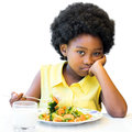 Bored Looking African Girl Sitting With Vegetable Dish. Royalty Free Stock Photo - 81553005