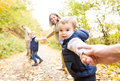 Beautiful Young Family On A Walk In Autumn Forest. Royalty Free Stock Image - 81568696