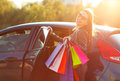 Smiling Caucasian Woman Putting Her Shopping Bags Into The Car Stock Image - 81636051