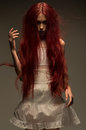 Red Haired Zombie Woman In White Cotton Dress Royalty Free Stock Photo - 81642395