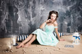 Attractive Woman In Retro Blue Dress With Candles And Striped Pillow Stock Image - 81647051
