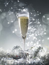 One Champagne Glass And Silver Decoration On A Silver Shiny Glit Royalty Free Stock Photos - 81651588