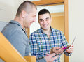 Service Employee With Tenant At Doorway Stock Images - 81652324