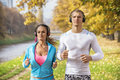 Beautiful Young Couple Listening Music And Running Together In The Park Royalty Free Stock Image - 81656666