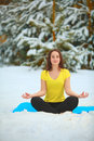 Beautiful Woman Doing Yoga Outdoors In The Snow Royalty Free Stock Image - 81659636