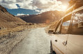 Expedition Vehicle With Baggage On It Roof On The Mountain Road Royalty Free Stock Images - 81693699