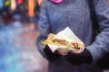 Sandwich In The Woman`s Hands. Street Food. Royalty Free Stock Photos - 81698078