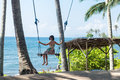 Sexy Young Woman Sitting On The Swing On The Tropical Beach, Paradise Island Bali, Indonesia. Sunny Day, Happy Vacation Stock Photos - 81713103
