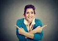 Confused Woman Pointing In Two Different Directions Royalty Free Stock Photo - 81717305