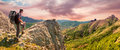 Hiker On The Top Enjoys Mountains Panorama Landscape Stock Photos - 81839923