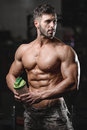 Handsome Athletic Fitness Man Holding A Shaker And Posing Gym Royalty Free Stock Image - 81888426