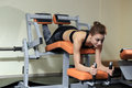 Leg Exercises - Young Woman Doing Leg With Machine In Gym Stock Photos - 81915923