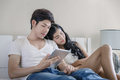 Asian Couple Activity In Bed Royalty Free Stock Photo - 81921585