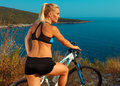 Woman Cyclist On A Mountain Bike Looking At The Landscape Of Mou Stock Images - 81945114