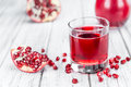 Portion Of Pomegranate Juice On Wooden Background Selective Foc Stock Photos - 81947963