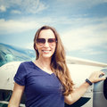 Young Smiling Woman Standing Near Private Plane Royalty Free Stock Photography - 81967527