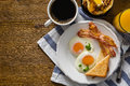 American Breakfast With Sunny Side Up Eggs, Bacon, Toast, Pancakes, Coffee And Juice Royalty Free Stock Photos - 81973468