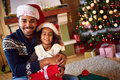 Afro American Father With Daughter For Christmas Eve Stock Image - 81982311
