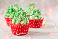 Christmas Cupcakes With Christmas Tree Shape, Sparkler And Lights Stock Photo - 81988380